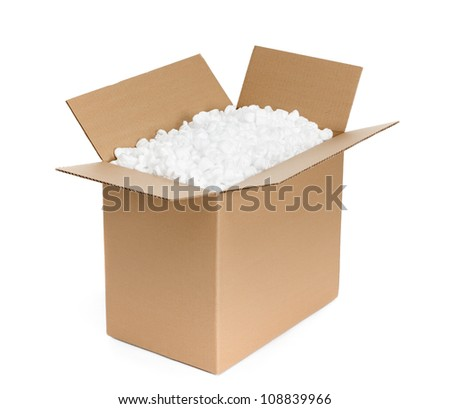 Opened cardboard container is filled with foam plastic shaving, isolated, white background