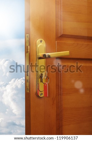 opened door with sky