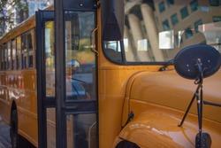Opened doors in yellow empty school bus.