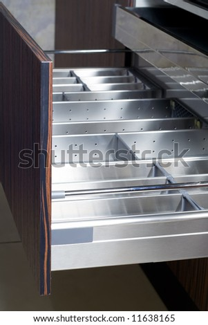 Opened drawers in stylish kitchen