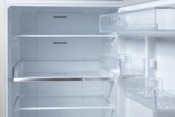Opened empty refrigerator. Refrigerator open empty fridge inside interior. close up on empty refrigerator with door open. New clean refrigerator.