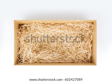 Opened gift box with decorative straw, filler, shavings