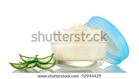 Opened glass jar of cream and aloe isolated on white