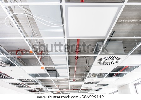 Shutterstock Opened hung ceiling at construction site