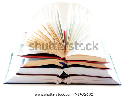 opened large book stack on white background