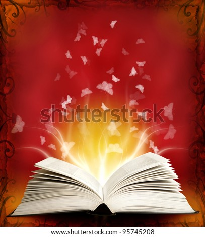 Opened magic book with magic light and butterfly. Education