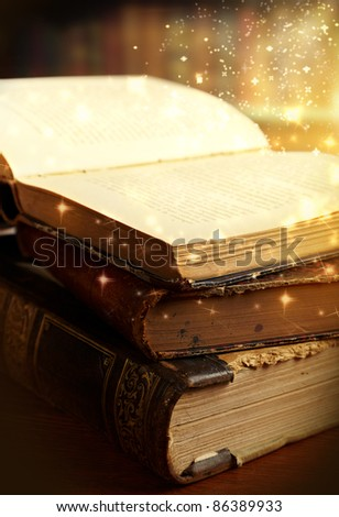 Opened magic book with magic light. Education - stock photo