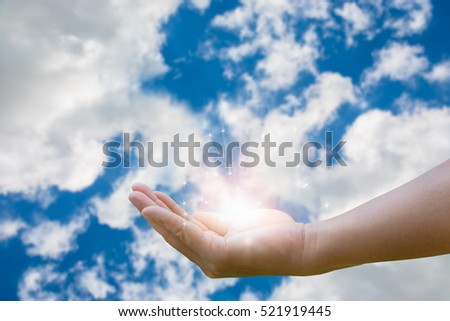 Opened magic hand with magic lights on blue sky background #521919445