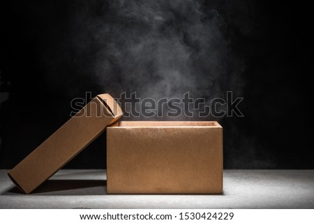 opened mystery box with smoke float up on dark background
