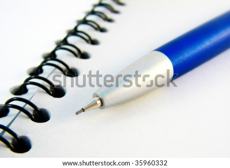 Opened notebook and the pencil