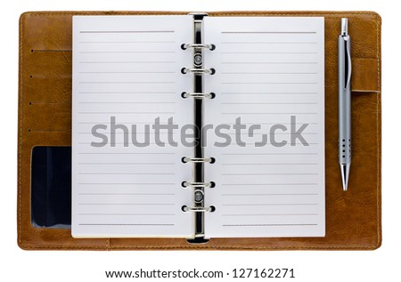 Opened notebook with pen isolated on white