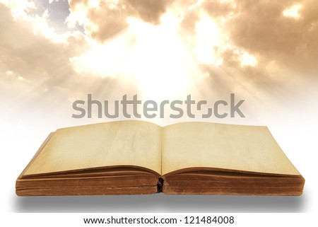 Opened old book with beautiful sky background