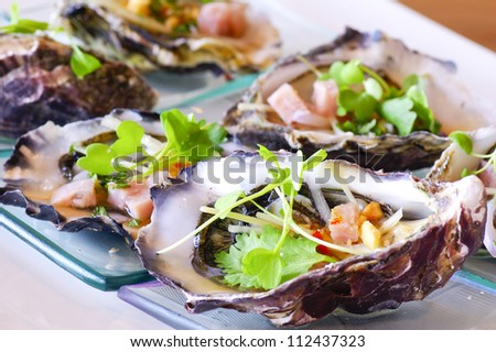 opened oyster food on dish