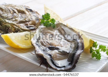 opened oyster on dish