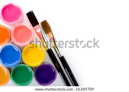 Opened paint buckets with brushes isolated