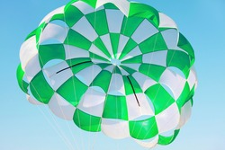 Opened parachute in flight . Extreme sport