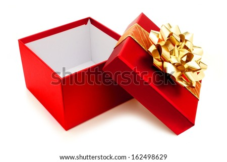Opened red Christmas gift box with gold bow and ribbon