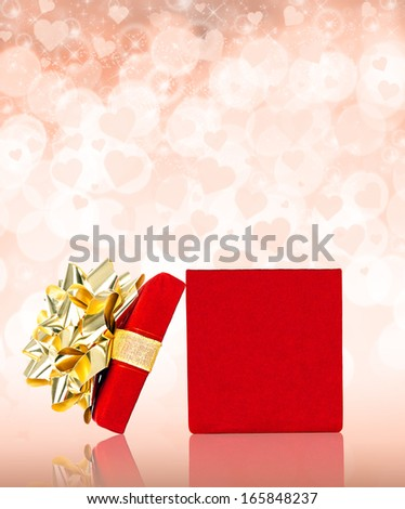 Opened Red Gift Box With Golden Bow for Any Holiday and Celebration Occasion, Isolated on White