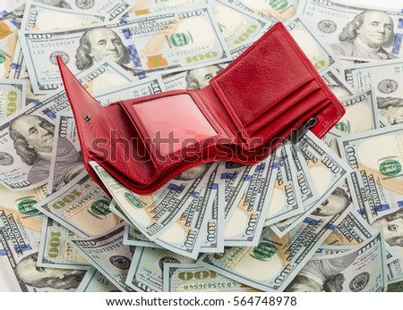opened red wallet with money  on money background