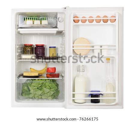 opened refrigerator full of foodstuff - stock photo