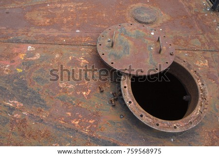 Opened rusty manhole on the black fuel tank fixed cone roof storage tank confined space #759568975