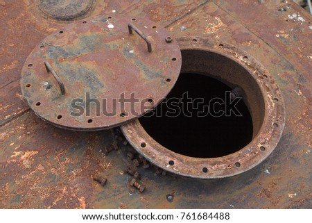 Opened rusty manhole on the black fuel tank fixed cone roof storage tank confined space #761684488