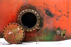 opened rusty manhole on the red fuel tank