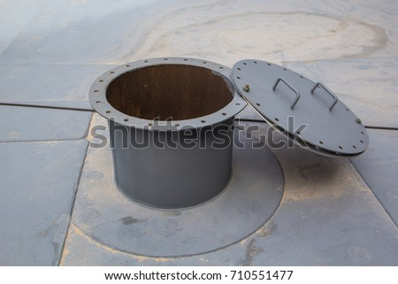 opened rusty manhole on the white fuel tank roof deck storage tank confined space #710551477