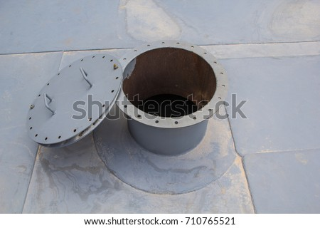 opened rusty manhole on the white fuel tank roof deck storage tank confined space #710765521