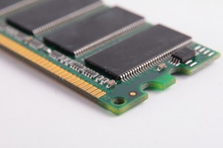 Opened solid state drive closeup on white background closeup details of computer memory (RAM)