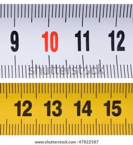 Opened tape measure on white isolated background - stock photo