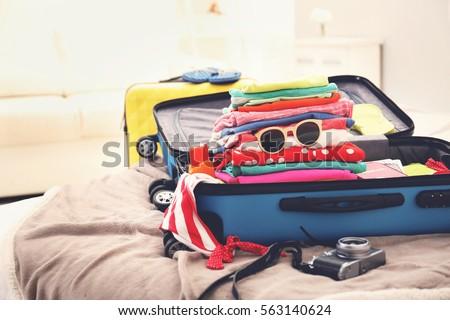 Opened traveler case on bed