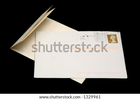 Opened UK Letter with 1st class stamp, with copyspace for address, isolated on black.