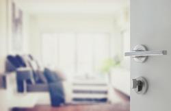 opened white door to modern bedroom interior