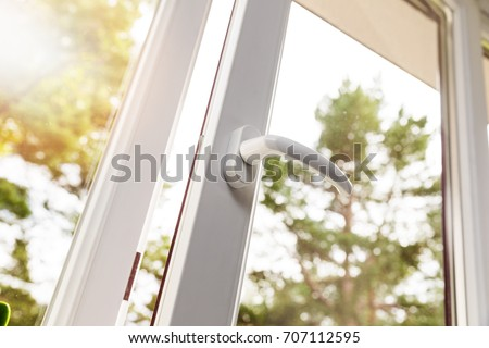 opened white plastic pvc window