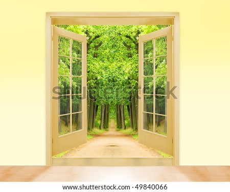 Opened wooden two-leaf door to early morning in green oak alley. Conceptual image.