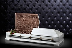 Opened wooden white sarcophagus isolated on gray luxury background. casket, coffin on royal background.