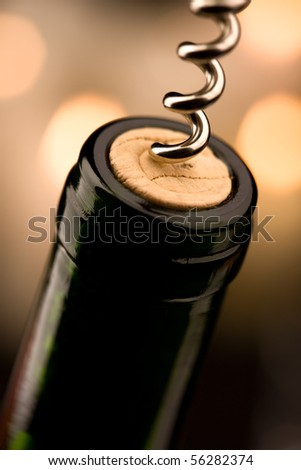 Opening a bottle of wine in celebration (shallow DOF)