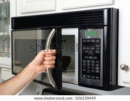opening a microwave door #106230449