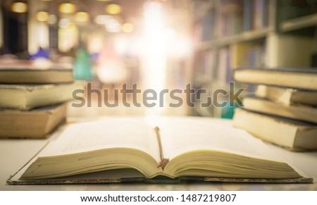 Opening holy bible with blurred cross background  #1487219807