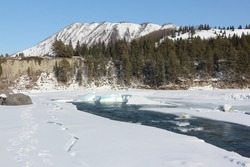 Opening of ice on the place of merge of the Katun River and Ursule's river, Altai, Russia