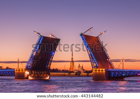 Opening of Palace drawbridge, White nights in Saint Petersburg, view of Peter and Paul Cathedral through the bridge