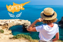 Opening of resort of Cyprus. Concept opening borders of Cyprus. Girl on background of rocks Ayia Napa. Opening of tourist season in Mediterranean. Travel to beaches of Cyprus. Travel Ayia Napa resort