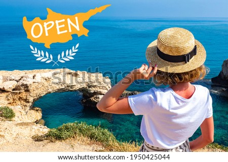 Opening of resort of Cyprus. Concept opening borders of Cyprus. Girl on background of rocks Ayia Napa. Opening of tourist season in Mediterranean. Travel to beaches of Cyprus. Travel Ayia Napa resort Stock fotó ©