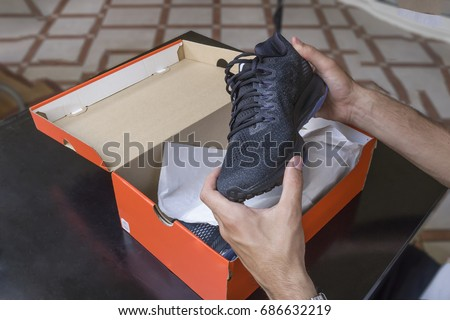 Stock Photo Opening the box of a new pair of shoes