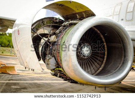 Opening the fan cowling,thrust reverser and core cowling on a jet engine for maintenance before flight.
