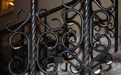 Openwork lattice of internal gates or railings Details of a figured antique forged metal fence lattice, decor elements