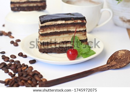 Opera cake is a cake originating from France, this cake is layered, and the layers consist of, almond sponge cake or commonly called joconda in French