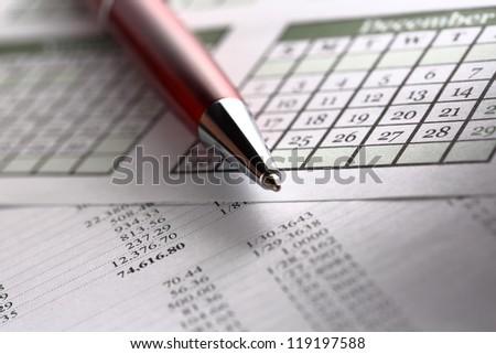 Operating budget, calendar and pen - stock photo