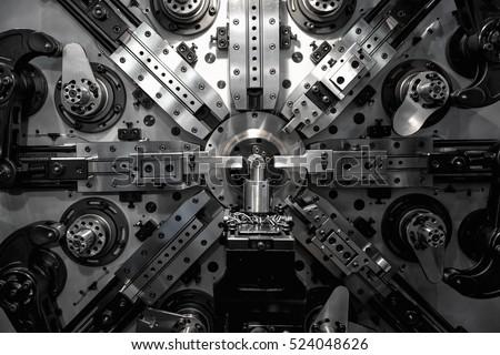 Operator machining automotive part by turning machine, Industry machine background